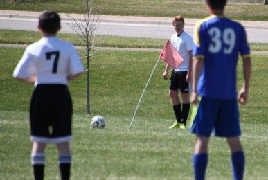 U14 Ben Lyons prepares for a corner kick as Ranger Bolton looks on