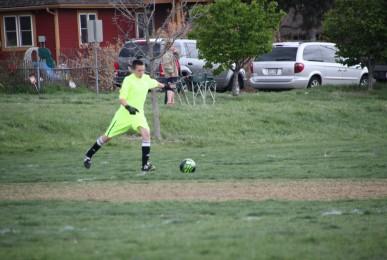 U14B Goalie Mason Hale with a goal kick.